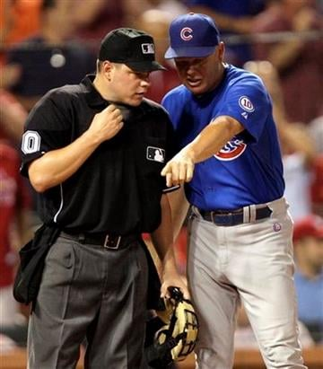 Chicago Cubs manager Mike Quade argues a call at the plate with home plate umpire D.J. Reyburn in the seventh inning of a baseball game, Friday, July 29, 2011 in St. Louis. (AP Photo/Tom Gannam) By Tom Gannam
