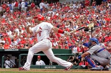 St. Louis Cardinals first baseman Albert Pujols (5) follows through on a solo home run as Chicago Cubs catcher Geovany Soto watches in the first inning of a baseball game, Saturday, July 30, 2011 in St. Louis.(AP Photo/Tom Gannam) By Tom Gannam