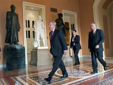 Senate Minority Leader Mitch McConnell of Ky. walks to the Senate floor on Capitol Hill in Washington, Friday, July 29, 2011.  (AP Photo/J. Scott Applewhite) By J. Scott Applewhite