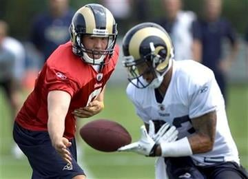 St. Louis Rams quarterback Sam Bradford, left, watches as wide receiver Austin Pettis bobbles the handoff during NFL football training camp Sunday, July 31, 2011, at the Rams' training facility in St. Louis. (AP Photo/Jeff Roberson) By Jeff Roberson