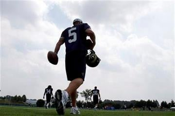St. Louis Rams punter Donnie Jones heads out to practice during NFL football training camp Sunday, July 31, 2011, at the Rams' training facility in St. Louis. (AP Photo/Jeff Roberson) By Jeff Roberson