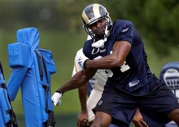 St. Louis Rams rookie first-round draft pick Robert Quinn works with a tackling sled during NFL football training camp on Sunday, July 31, 2011, at the Rams' facility in St. Louis. (AP Photo/Jeff Roberson) By Jeff Roberson