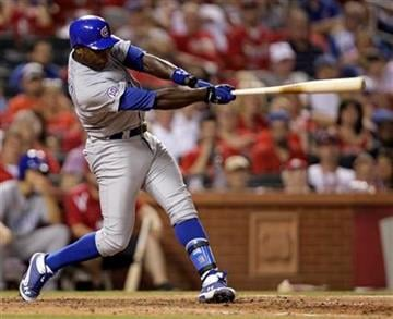 Chicago Cubs' Alfonso Soriano follows through on a two-run home run in the ninth inning of a baseball game against the St. Louis Cardinals, Sunday, July 31, 2011 in St. Louis. The Cubs beat the Cardinals 6-3. (AP Photo/Tom Gannam) By Tom Gannam