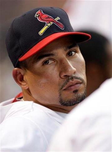 Newly acquired St. Louis Cardinals' Rafael Furcal, traded from the Los Angeles Dodgers, sits on the bench in the fourth inning of a baseball game against the Chicago Cubs, Sunday, July 31, 2011 in St. Louis. (AP Photo/Tom Gannam) By Tom Gannam