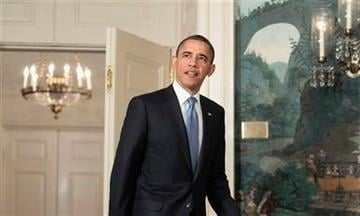 President Barack Obama walks into the Diplomatic Reception Room of the White House in Washington,  Friday, July 29, 2011, to talk about the ongoing budget ceiling negotiations.  (AP Photo/Pablo Martinez Monsivais) By Pablo Martinez Monsivais
