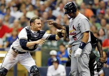 Milwaukee Brewers' Jonathan Lucroy, left, tags out St. Louis Cardinals' Albert Pujols (5) during the seventh inning of a baseball game Monday, Aug. 1, 2011, in Milwaukee. (AP Photo/Jeffrey Phelps) By Jeffrey Phelps