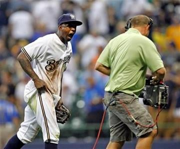 Milwaukee Brewers' Nyjer Morgan reacts for a television camera after defeating the St. Louis Cardinals 6-2 in a baseball game Monday, Aug. 1, 2011, in Milwaukee. (AP Photo/Jeffrey Phelps) By Jeffrey Phelps