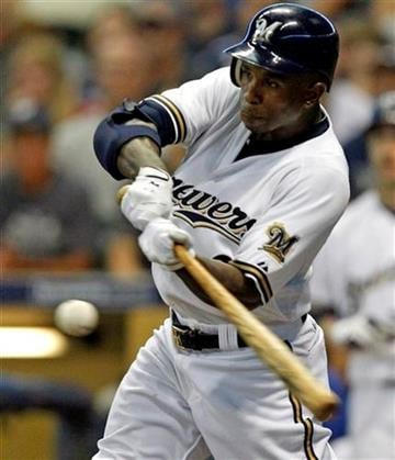 Milwaukee Brewers' Nyjer Morgan hits a three-run double during the fifth inning of a baseball game against the St. Louis Cardinals Monday, Aug. 1, 2011, in Milwaukee. (AP Photo/Jeffrey Phelps) By Jeffrey Phelps