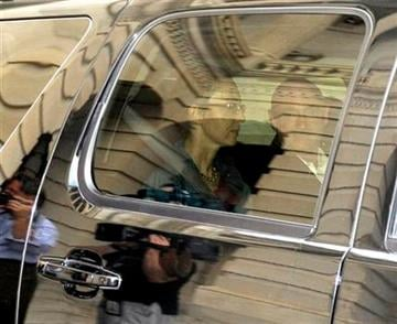 Rep. Gabrielle Giffords, D-Ariz., sits in a car with her husband Mark Kelly as she leaves the U.S. Capitol after she appeared on the House floor to vote on debt legislation in Washington, Monday, Aug. 1, 2011. (AP Photo/Susan Walsh) By Susan Walsh