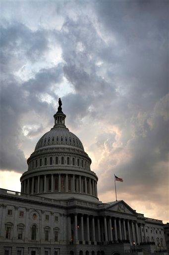 The U.S. Capitol is seen just after the House voted to pass debt legislation on Capitol Hill in Washington, on Monday, Aug. 1, 2011. (AP Photo/Jacquelyn Martin) By Jacquelyn Martin