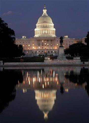 The U.S. Capitol in Washington is illuminated as the debt-limit stalemate continues Saturday night, July 30, 2011.  (AP Photo/J. Scott Applewhite) By J. Scott Applewhite