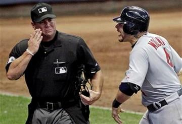 St. Louis Cardinals' Yadier Molina argues with home plate umpire Rob Drake after being called out on strikes during the 10th inning of a baseball game against the Milwaukee Brewers Tuesday, Aug. 2, 2011, in Milwaukee. (AP Photo/Morry Gash) By Morry Gash