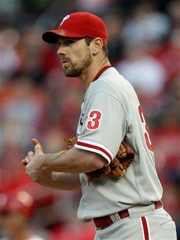 Philadelphia Phillies starting pitcher Cliff Lee rubs up a new ball after walking St. Louis Cardinals' Lance Berkman during the fourth inning of a baseball game Monday, May 16, 2011, in St. Louis. (AP Photo/Jeff Roberson) By Jeff Roberson