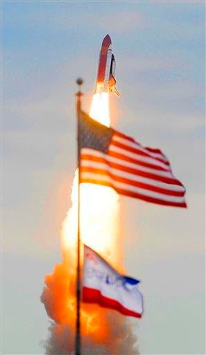 Space shuttle Endeavour flies past the US and mission flags after launch at Cape Canaveral, Fla., on Monday, May 16, 2011. AP Photo/Florida Today, Craig Rubadoux) By Craig Rubadoux