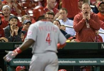A St. Louis Cardinals' fan yells at Cincinnati Reds' Brandon Phillips after he flied out during the ninth inning of a baseball game Friday, April 22, 2011, in St. Louis. The Cardinals won 4-2. (AP Photo/Jeff Curry) By Jeff Curry