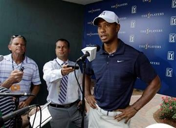 Tiger Woods speaks to the media after withdrawing during the first round of The Players Championship golf tournament Thursday May 12, 2011 in Ponte Vedra Beach, Fla.  (AP Photo/Chris O'Meara) By Chris O'Meara