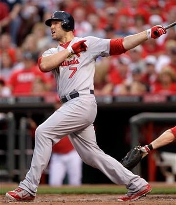 St. Louis Cardinals' Matt Holliday hits a double off Cincinnati Reds starting pitcher Bronson Arroyo to drive in a run in the fourth inning of a baseball game, Friday, May 13, 2011, in Cincinnati. (AP Photo/Al Behrman) By Al Behrman