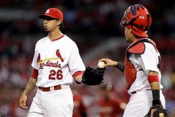 St. Louis Cardinals starting pitcher Kyle Lohse, left, is handed a ball by catcher Yadier Molina during the second inning of a baseball game against the Houston Astros on Wednesday, May 18, 2011, in St. Louis. (AP Photo/Jeff Roberson) By Jeff Roberson