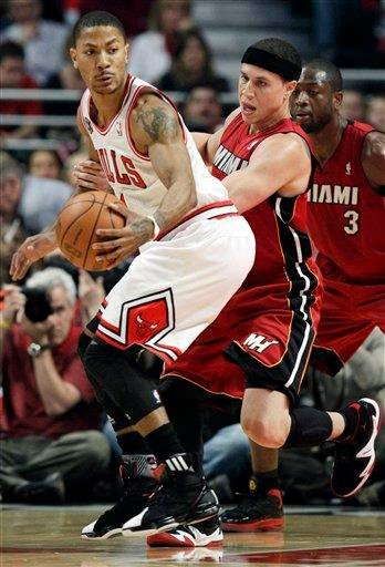 Chicago Bulls guard Derrick Rose, left, drives against Miami Heat guard Mike Bibby during the first quarter in Game 2 of the NBA basketball Eastern Conference finals on Wednesday, May 18, 2011, in Chicago. (AP Photo/Nam Y. Huh) By Nam Y. Huh