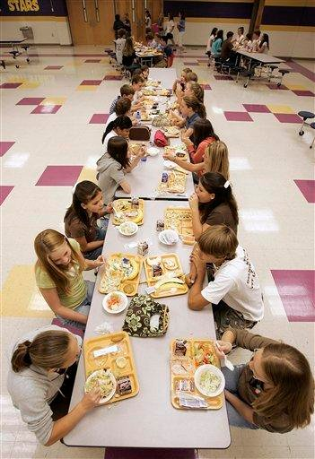 FILE - In this Aug. 18, 2006 file photo, students eat lunch at Pleasant View Middle School in Springfield, Tenn. The U.S. government is trying new approaches to get kids to choose healthier foods. (AP Photo/Mark Humphrey, File) By MARK HUMPHREY