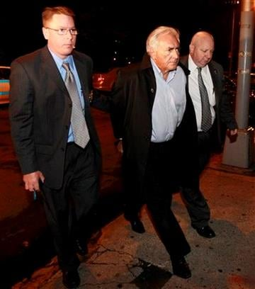 International Monetary Fund leader Dominique Strauss-Kahn, center, is brought into the Municipal Court, Monday, May 16, 2011 in New York. Strauss-Kahn is accused of sexually assaulting a maid in his hotel room. (AP Photo/Julio Cortez) By Julio Cortez