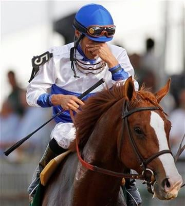 Jesus Castanon (5) reacts aboard Shackleford after winning the 136th Preakness Stakes horse race at Pimlico Race Course, Saturday, May 21, 2011, in Baltimore. (AP Photo/Patrick Semansky) By Patrick Semansky