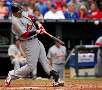 St. Louis Cardinals' Allen Craig hits a two run home run during the third inning of a baseball game against the Kansas City Royals Sunday, May 22, 2011, in Kansas City, Mo. (AP Photo/Charlie Riedel) By Charlie Riedel