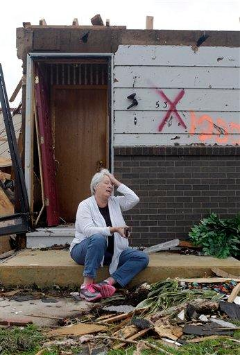 Shirley Waits sits outside her mother's home and waits for an insurance adjuster to arrive Wednesday, May 25, 2011, in Joplin , Mo. A massive tornado moved through Joplin Sunday night leveling much of the city. (AP Photo/Jeff Roberson) By Jeff Roberson