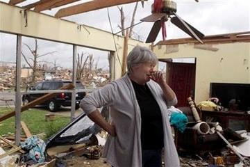 Shirley Waits cries as she stands in what is left of her mother's home Wednesday, May 25, 2011, in Joplin , Mo. A massive tornado moved through Joplin Sunday night leveling much of the city. (AP Photo/Jeff Roberson) By Jeff Roberson