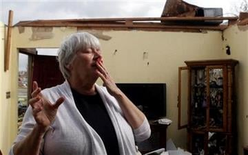 Shirley Waits pauses as she stands in what was her mother's living room Wednesday, May 25, 2011, in Joplin , Mo. A massive tornado moved through Joplin Sunday night leveling much of the city. (AP Photo/Jeff Roberson) By Jeff Roberson