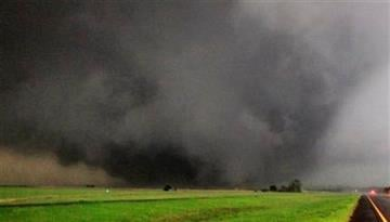 A half-mile-wide tornado moves north in Canadian County after having just crossed SH-3, the Northwest Expressway, west of SH-4 moving towards Piedmont, Okla. Tuesday, May 24, 2011. (AP Photo/The Oklahoman, Paul Southerland) By PAUL B. SOUTHERLAND