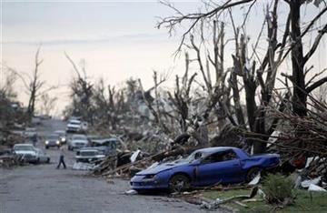 Tornado damage is seen Monday, May 23, 2011, in Joplin, Mo. A large tornado moved through much of the city Sunday, damaging a hospital and hundreds of homes and businesses and killing at least 89 people. (AP Photo/Jeff Roberson) By Jeff Roberson