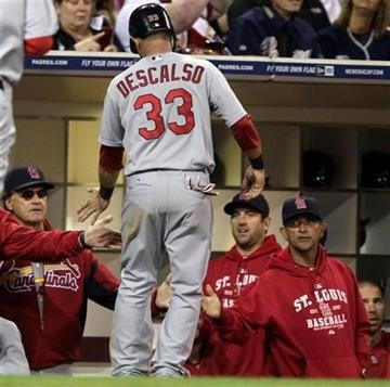 St. Louis Cardinals' Daniel Descalso is greeted at the dugout after scoring in the seventh inning against the San Diego Padres during a baseball game Tuesday, May 24, 2011, in San Diego. (AP Photo/Lenny Ignelzi) By Lenny Ignelzi