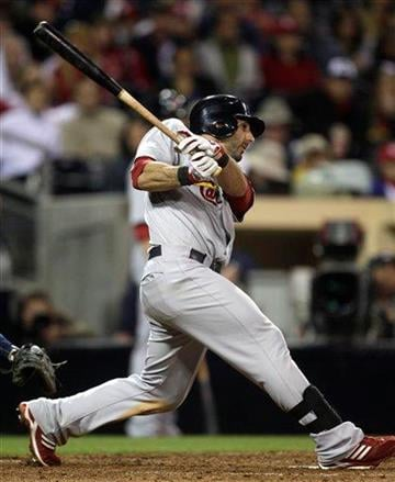 St. Louis Cardinals' Daniel Descalso hits a hard grounder up the middle to drive in the go ahead run against the San Diego Padres in the 11th inning of a baseball game Tuesday, May 24, 2011 in San Diego. (AP Photo/Lenny Ignelzi) By Lenny Ignelzi