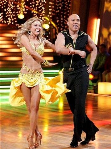 """In this publicity image released by ABC, Hines Ward, right, and his partner Kym Johnson perform on the celebrity dance competition series, """"Dancing with the Stars,"""" Monday, April 4, 2011 in Los Angeles. (AP Photo/ABC, Adam Taylor) By Adam Taylor"""