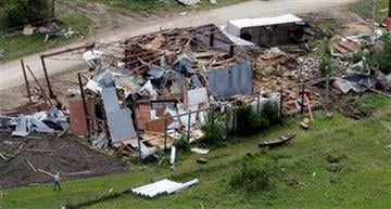 Residents survey tornado damage on a farm near Reading, Kan., Monday, May 23, 2011. (AP Photo/Orlin Wagner) By Orlin Wagner