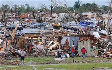 Residents of Joplin, Mo, survey the damage of their homes and city on Monday, May 23, 2011. A tornado that struck Joplin, Mo, on Sunday, May 22, killed over 120 and injured hundreds more. (AP Photo/Mike Gullett) By Mike Gullett