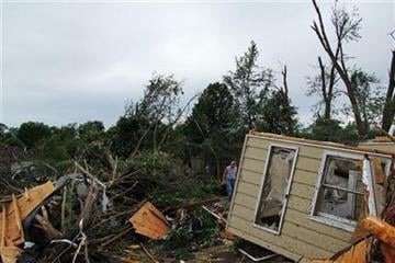 A man makes his way through the wreckage of a home damaged by a tornado in Sedalia, Mo., on Wednesday, May 25, 2011. (AP Photo/Dan Gill) By Dan Gill