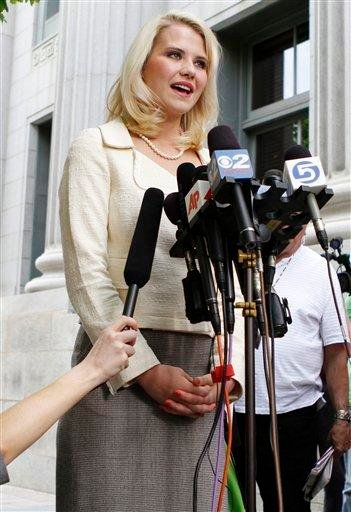 Elizabeth Smart talks to the media in front of the Frank E. Moss Federal Courthouse, Wednesday, May 25, 2011, in Salt Lake City. Smart's kidnapper, Brian David Mitchell, was sentenced to life in prison. (AP Photo/Jim Urquhart) By Jim Urquhart