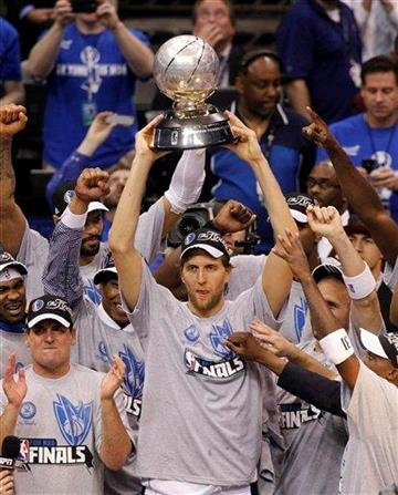 Dallas Mavericks forward Dirk Nowitzki holds up the trophy after the Mavericks defeated the Oklahoma City Thunder 100-96 for the NBA basketball Western Conference title, Wednesday, May 25, 2011, in Dallas. (AP Photo/LM Otero) By LM Otero