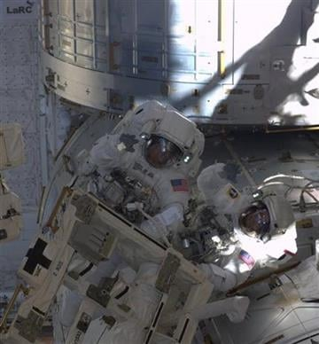In this image provided by NASA astronauts Andrew Feustel (right) and Michael Fincke wave to astronaut Ron Garan in the International Space Stationb's cupola window during third space walk, on May 25, 2011. (AP Photo/NASA - Ron Garan) By Ron Garan