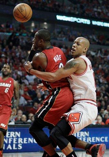Miami Heat guard Dwyane Wade, left, is fouled by Chicago Bulls guard Keith Bogans during the first quarter of Game 5 of the NBA basketball Eastern Conference finals Thursday, May 26, 2011, in Chicago. (AP Photo/Nam Y. Huh) By Nam Y. Huh