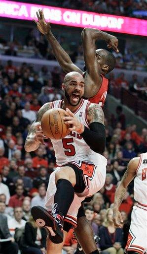 Chicago Bulls forward Carlos Boozer (5) grabs a rebound against Miami Heat center Joel Anthony during the first quarter of Game 5 of the NBA basketball Eastern Conference finals Thursday, May 26, 2011, in Chicago. (AP Photo/Nam Y. Huh) By Nam Y. Huh