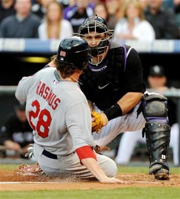 St. Louis Cardinals' Colby Rasmus (28) is tagged out at home plate by Colorado Rockies catcher Chris Iannetta (20) during the second inning of an MLB baseball game, Friday, May 27, 2011, in Denver. (AP Photo/Jack Dempsey) By Jack Dempsey