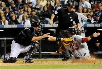 Colorado Rockies catcher Chris Iannetta (20) tags out St. Louis Cardinals' Daniel Descalso (33) at home plate during the sixth inning of an MLB baseball game, Friday, May 27, 2011, in Denver. (AP Photo/Jack Dempsey) By Jack Dempsey