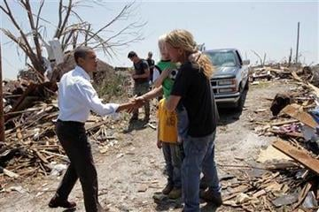 President Barack Obama, left, reaches out to residents while viewing damage from the tornado that devastated Joplin, Mo., Sunday, May 29, 2011.   (AP Photo/J. Scott Applewhite) By J. Scott Applewhite