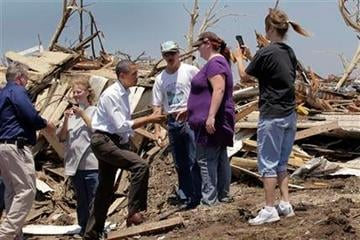President Barack Obama, third from left, talks with residents while viewing damage from the tornado that devastated Joplin, Mo., Sunday, May 29, 2011.   (AP Photo/J. Scott Applewhite) By J. Scott Applewhite