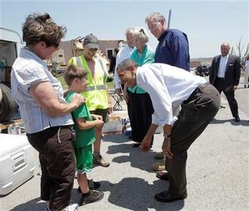 President Barack Obama, right, meets with volunteers as he views damage from the tornado that devastated Joplin, Mo., Sunday, May 29, 2011.   (AP Photo/J. Scott Applewhite) By J. Scott Applewhite