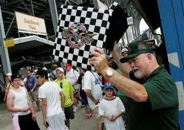 Eddie Lawyer, right, of Plainfield, Ind., sells seat cushions during the Indianapolis 500 auto race at the Indianapolis Motor Speedway in Indianapolis, Sunday, May 29, 2011. (AP Photo/Tom Strattman) By Tom Strattman