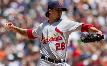 St. Louis Cardinals starting pitcher Kyle Lohse (26) pitches to Colorado Rockies second baseman Eric Young Jr. (1) during the first inning of a baseball game Sunday, May 29, 2011 in Denver. (AP Photo/Barry Gutierrez) By Barry Gutierrez